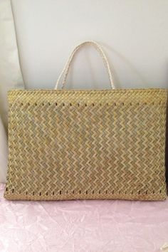 This beautifully one-off woven kete whakairo, made from harakeke (NZ flax), and muka (flax fibre). Its pattern is puareare (holes). The kete was made from Flax Weaving, Bamboo Weaving, Weaving Art, Rope Basket, Basket Weaving, Flax Fiber, Pinwheel Bow, Maori Designs, Best Bow