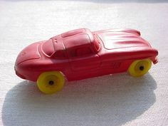 Vintage Auburn Rubber Toy Car Sports Two Door Red w Yellow Wheels made in USA  ~ seller; florasgarden on ebay