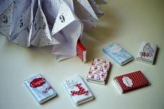 Calendario de adviento de origami en forma de copo de nieve