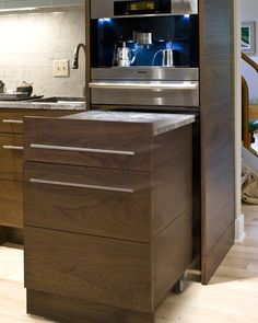 Pull-out counterspace. Genius! The built in coffee maker is nice too. :-)