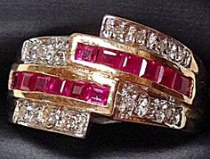 $399 Vintage 10K Yellow Gold Band Ring with Square cut Channel Set Red Rubies & Diamond Accents in size 7. 12 Square cut rubies are approx 2mm each.  14 round 1mm diamond accents. The ring is 1/2 inch wide on top.