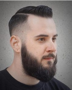 Tight fade with a bit of a Pomp on top and a full beard. .. .. #hair #hairstyle #instahair #hairstyles #hairdo #haircut #fashion #instafashion  #style #hairoftheday #hairideas #hairfashion #hairofinstagram #coolhair #beards #menshair #beardcare #grooming #veganfriendly #vegan #mensgrooming #dapper #beardsofinstagram #nopoo