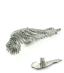 A must have jewelery addition to a girly day look or team with shimmering metallics for that  take on going out glam. Give your after-hours style extra impact by wearing this statement feather ring.$10.99