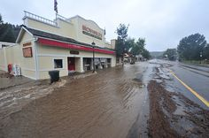 eptrail > Water rushes past Brownfields on Elkhorn Avenue on Thursday. Much of the tourist economy of Elkhorn and Estes Park will be disrupt...