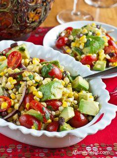 A delicious Avocado, Corn and Tomato Salad with a Cilantro-Lime Dressing.  So good!