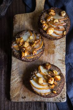Hazelnut buckwheat pear financiers - made with browned butter and toasted hazelnut meal, topped with juicy pears, and crunchy caramelized hazelnuts, these mini gluten free cakes are moist and buttery, with an irresistible nutty flavor. | www.viktoriastable.com