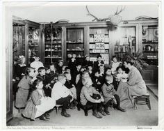 A librarian tells a story at the Webster Branch of the New York Public Library, 1910.