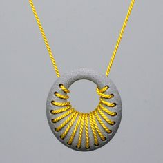 Featured at SXSW 2013: 3D Printed aluminum loop pendant with silk cord woven into the design Maybe something for 3D Printer Chat?