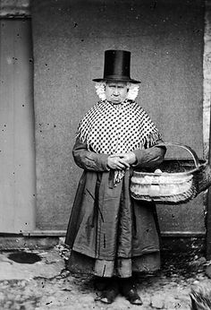Peoples Collection Wales - Mary Parry, Llanfechell, wearing Welsh national dress and carrying a basket, c. 1875