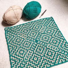 This crochet pattern looks a lot like Mosaic Knitting. It's supposed to be a throw, but worked in heavier yarn it would be a nice rug.