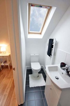 Toilet under velux, and wall standing radiator next to it Small Loft Bedroom, Small Attic Bathroom, Loft Bedrooms, Attic Loft, Loft Room, Upstairs Bathrooms, Loft Ensuite, Downstairs Cloakroom, Loft Bathroom
