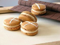 If you're a fan of Hot Cross Buns, you'll love these french macarons! Filled with a spiced cream cheese cream and topped with the traditional X. Perfect for Easter.