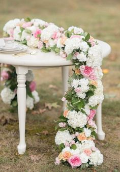 Love this floral table runner! Make it with silk flowers months before the wedding and it will still look fresh on your wedding day. A great way to save time and money. http://Afloral.com