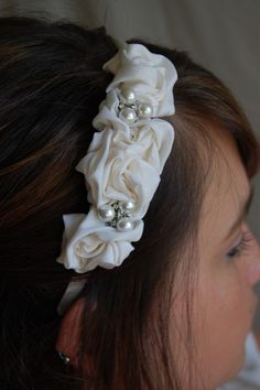 Ivory Rosette and Pearl Cluster Headband: Silk rosettes hand shaped from a vintage wedding gown adorned with a pair og vintage pearl and rhinestone earrings/