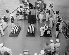 Three caskets, two containing the remains of WW2 Unknowns, and one containing the remains of a Korean War Unknown, are given the proper honors abroad USS Canberra. One WW2 Unknown and the Korean War Unknown were eventually interred beside their WW1 comrade, 1958.
