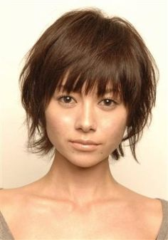 Love the hair cut. Wish mine would do this :)