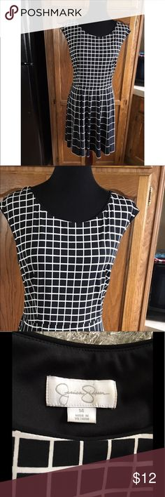 Jessica Simpson Fit and Flare Dress Size 14 Fit and flare style dress by Jessica Simpson.  Black and white checker print.  Cap sleeve.  Size 14.  Dress is 37 inches long.  Great condition.  Important:   All items are freshly laundered as applicable prior to shipping (new items and shoes excluded).  Not all my items are from pet/smoke free homes.  Price is reduced to reflect this!   Thank you for looking! Jessica Simpson Dresses Mini