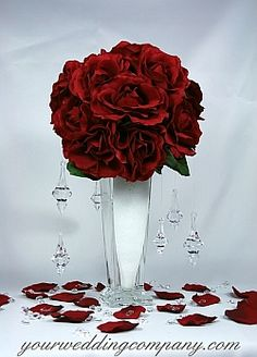 Pretty red wedding centerpiece using faux snow vase filler and hanging acrylic crystals. http://www.yourweddingcompany.com/index.php/action/purchase/productId/757/categoryId/