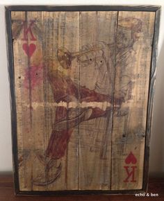 Framed playing card on reclaimed wood trumpet playing King of Hearts. Give your home decor a genuine vintage feel. This nostalgic art work will never go out of style. All of our art is hand made on th