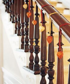 Chinese lantern plants attached to velvet ribbons are the perfect simple decoration for your banister.