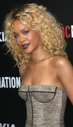 Another view of Ri-Ri's blonde curly look. Love this cut.