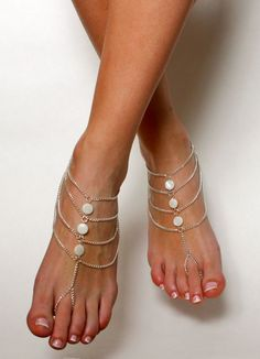 This listing is for A PAIR of chained bohemian barefoot sandals, as pictured above.  When purchasing this pair of barefoot sandals you will receive a pair of silver plated chained bohemian barefoot sandals. The sandals are handcrafted using silver plated chain, adjustable closure and 3 round white, fatback Mother of The Pearl beads on each pair of the sandals.  The sandals sits comfortably on your feet and do not restrict the natural movement of your feet. Wear barefoot, in the ocean, ..