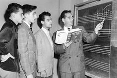 1945: Berklee founder Lawrence Berk at the blackboard with students.