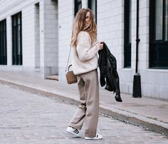 Get this look: http://lb.nu/look/7956948  More looks by Gabrielle L.: http://lb.nu/dentelleetfleurs  Items in this look:  Aritzia Heavy Knit, Aritzia Wide Pants, Adidas Superstar, Aritzia Leather Jacket   #casual #minimal #preppy