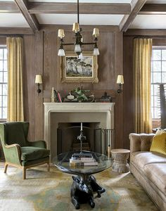 For the living room of a home in Palmetto Bluff, South Carolina, MIchelle Smith matched sunny-yellow Rose Tarlow curtains and a green-velvet chair by Jonas Workroom with a mid-20th-century coffee table in the form of a bronze antelope. Photo by Joy Sohn
