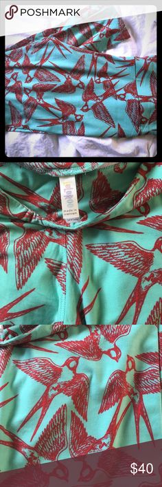 LuLaRoe T/C Tall and Curvy Leggings NEW NWT LuLaRoe famous butter soft leggings in size tall and curvy.This is vintage print that is no longer current. The colors are a pale green/blue color with red birds. LuLaRoe Pants Leggings