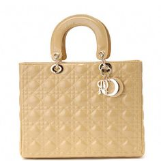 The large Lady Dior bag in beige lambskin with gold hardware