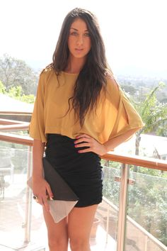 high waisted skirt + mustard slit top + cute clutch