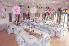 Harmans Cross Village Hall Wedding decorations with bunting and pompoms.  Photography by one thousand words wedding photographers
