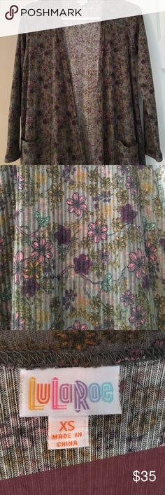 LulaRoe Sarah Cardigan XS LulaRoe Sarah cardigan. No holes, stains. Tan/brown in color with pink, turquoise, purple, and yellow flowers. LuLaRoe Sweaters Cardigans