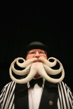 A competitor poses for a photograph while competing during the World Beard and Moustache Championships at the Brighton Centre on September 1, 2007 in Brighton, England. The World Beard and Moustache Championships is a biennial event participated by beard and moustache wearers from all over the world. (Photo by Daniel Berehulak/Getty Images)