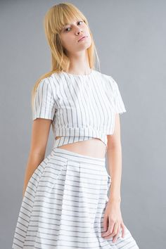 white set with stripes that has a cropped top and high waisted skirt.
