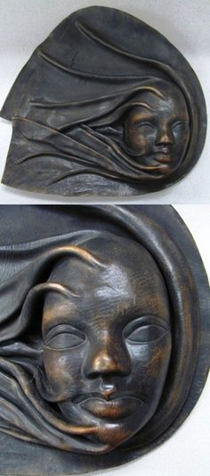 Hand-molded leather wall mask, signed, from Costa Rica