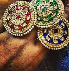 Cocktail rings in Kundan and Polki with rubies/emeralds/sapphire by Umrao Jewellers via Instagram