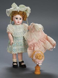 "Theriault's - 8"" Wonderful All-Original French Bisque Bebe Steiner with Two Original Costumes and Presentation Box, c 1890"