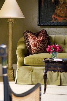 green sofa with flower button detail