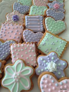 Heart, flower and square sugar cookies iced in pink, green and purple royal icing