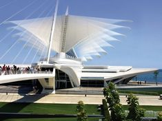 "Milwaukee Art Museum -- Protective ""wings"" go up for a sun screen over the glass, then fold down to protect it at night or when the wind is strong. Designed by Santiago Calatrava. More info found at inhabitat.com by clicking on image."