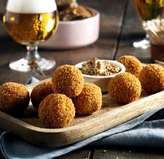 Bitterballen are typically Dutch snacks. They are served with french fries or with a drink at a party or small gathering. Mustard is a necessity when eating bitterballen.