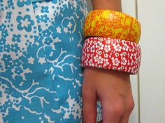 Modpodge and fun paper over old plastic bangle bracelets! Think of the possibilities. Rhinestones over the paper? Yes please!