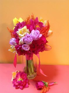 Lavender, yellow and orange tulips, pinky-purple dahlias, pink roses, yellow alstroemeria, and orange celosia make up this autumn bouquet. Sure looks like summer!
