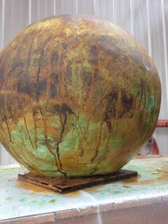 """24"""" concrete ball 1/2"""" thick made over a yoga ball. i will post how to video on you tube soon."""