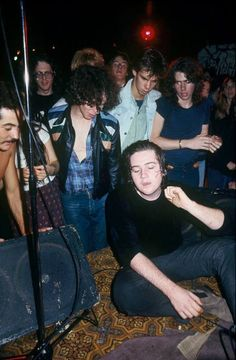 A young Nick Cave (in the light denim jacket) at a Saints gig (1977 Australia) The Saints lead singer Chris Bailey sitting on stage. Photo: Rennie Ellis