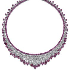 RUBY AND DIAMOND NECKLACE. The fine supple mesh of bib design, set with rose-cut diamonds to an inner line of circular-cut rubies, the edges trimmed with similarly cut and oval rubies of various sizes, length approximately 400mm, pouch