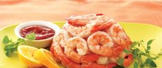 Enjoy this distinctive platter heaped with shrimp and served with a tangy cocktail sauce – a delicious seafood appetizer!