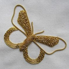 Embroidery Designs This glistening butterfly design combines a range of goldwork embroidery techniques on a background of calico fabric. With all of the fabrics, threads, needles Hand Work Embroidery, Butterfly Embroidery, Gold Embroidery, Embroidery Jewelry, Hand Embroidery Patterns, Embroidery Kits, Embroidery Stitches, Embroidery Tattoo, Indian Embroidery